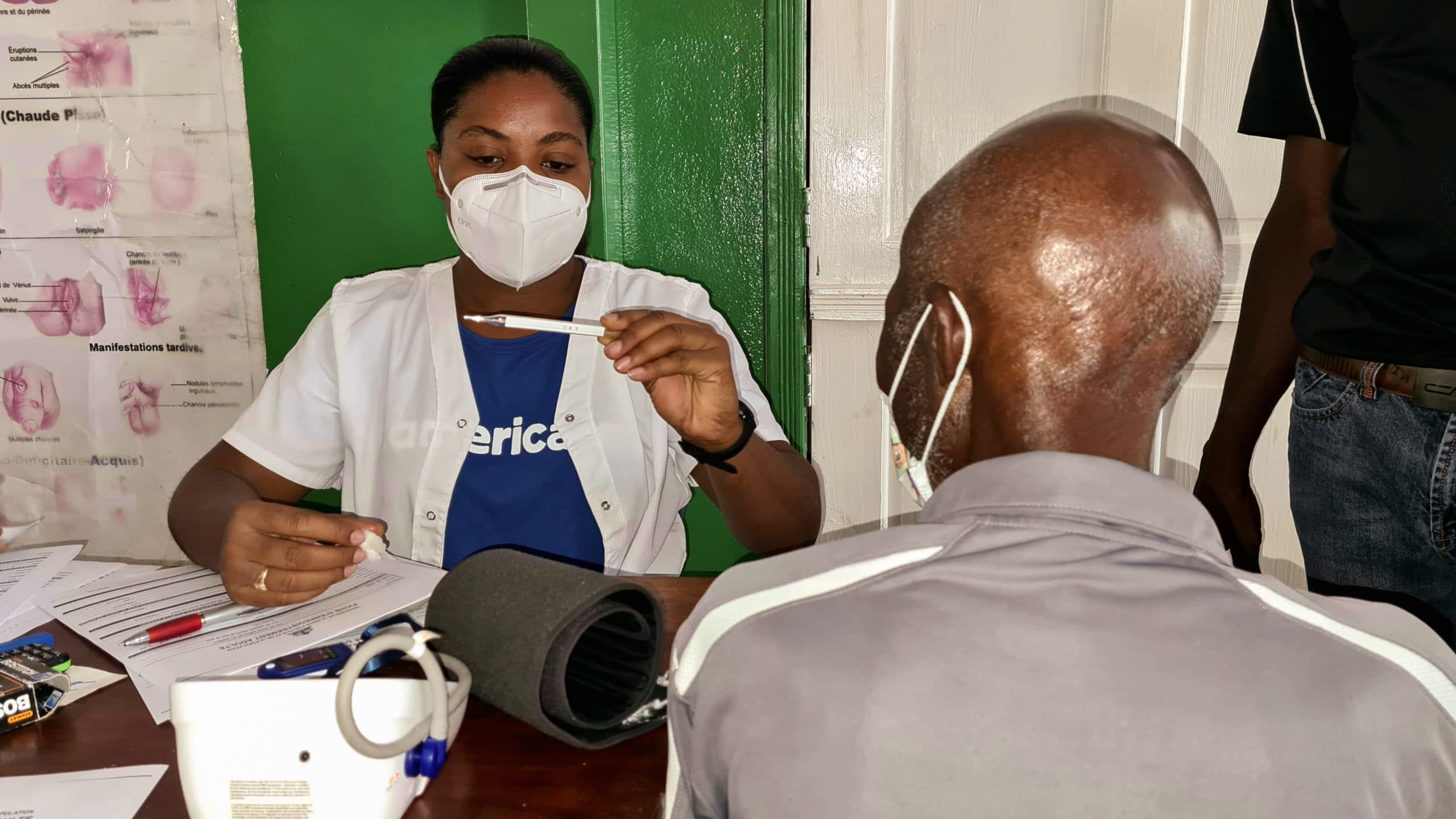 An Americares medical team member checks a patient after Haiti earthquake