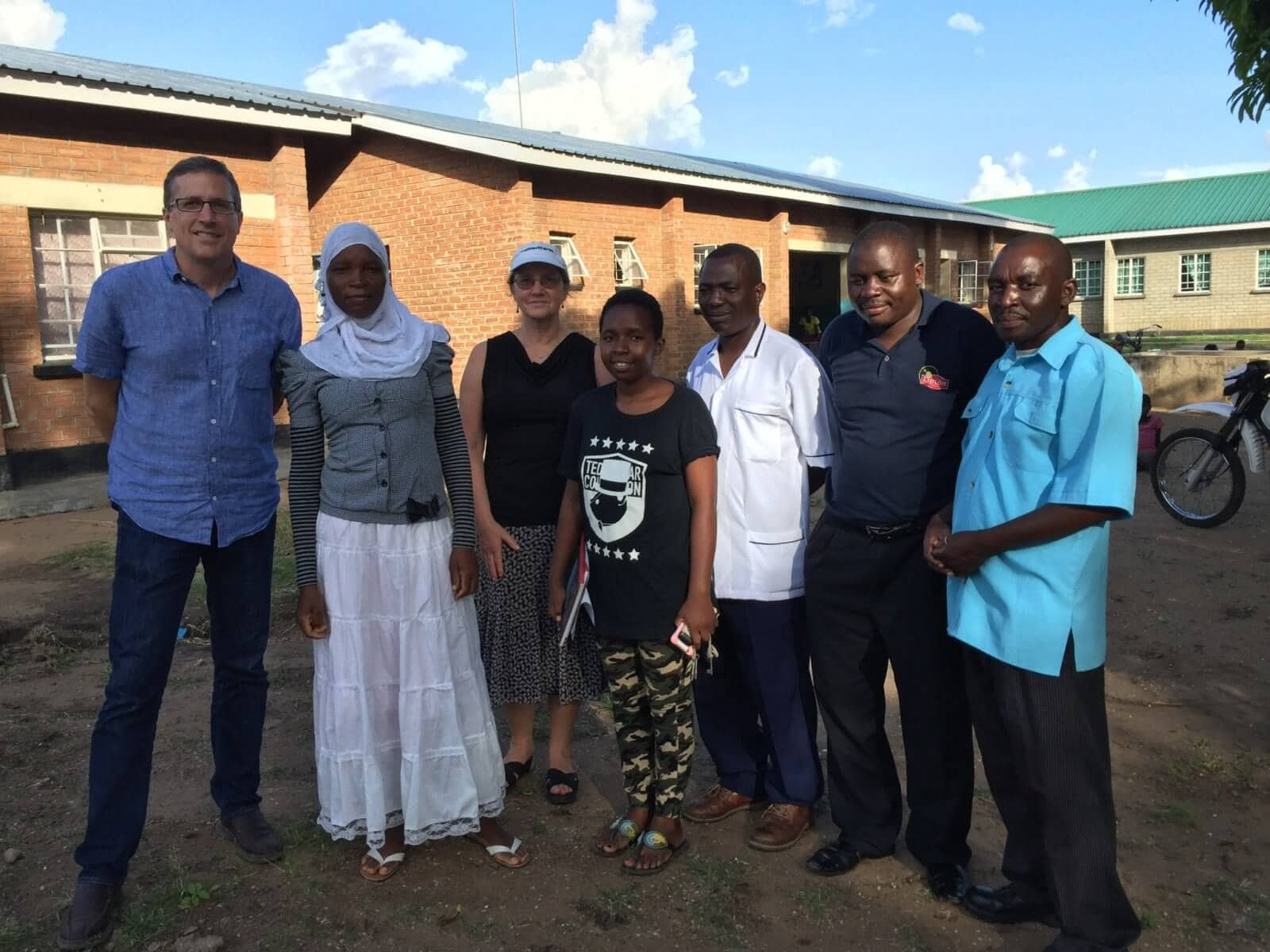 Michael Nyenhuis and Dr. E. Anne Peterson of Americares with staff from the Malombe health center in Malombe, Malawi.