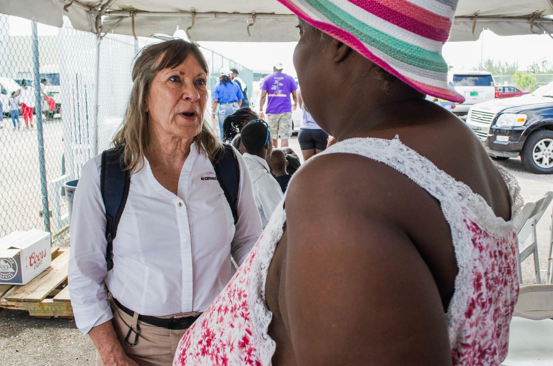 Americares emergency responder Lisa LaDue talks with Hurricane Dorian survivor Juliette