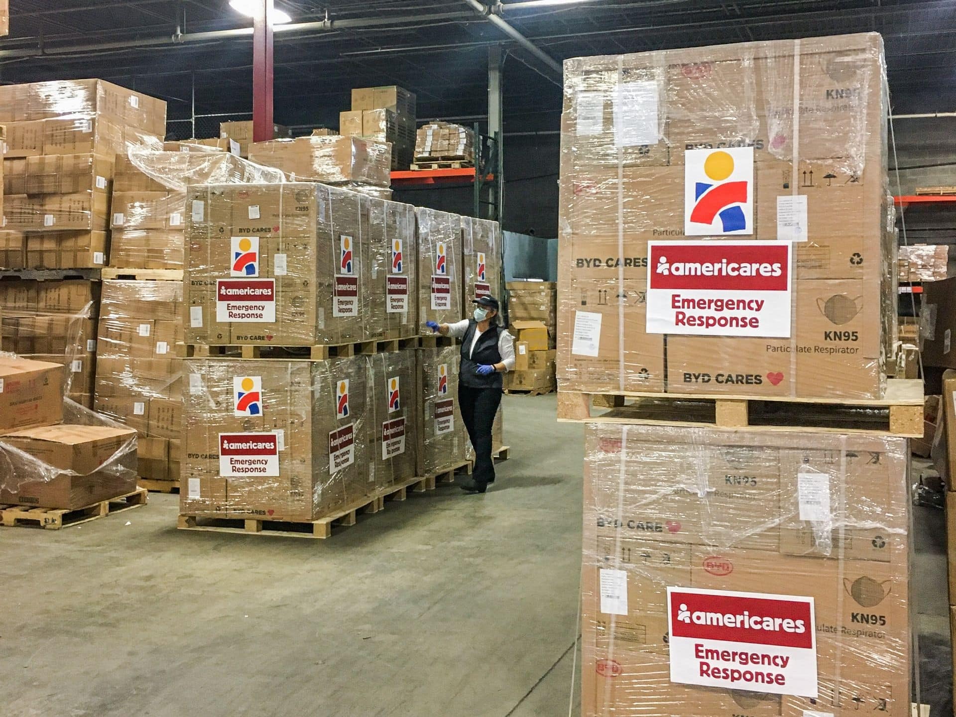 Americares Vice President of Global Program Operations Martha Kennard inspects a shipment of 300,000 KN95 masks for health workers in New York City.