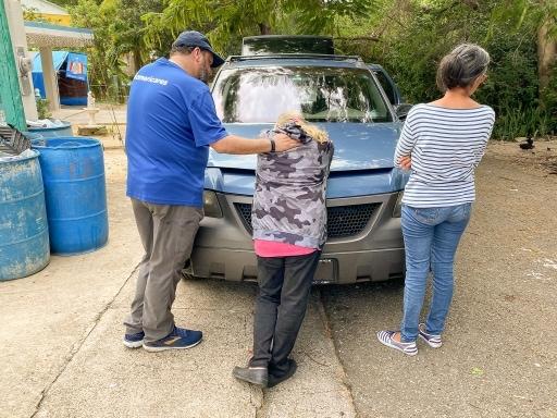 Emergency team comforting Puerto Rico earthquake survivor