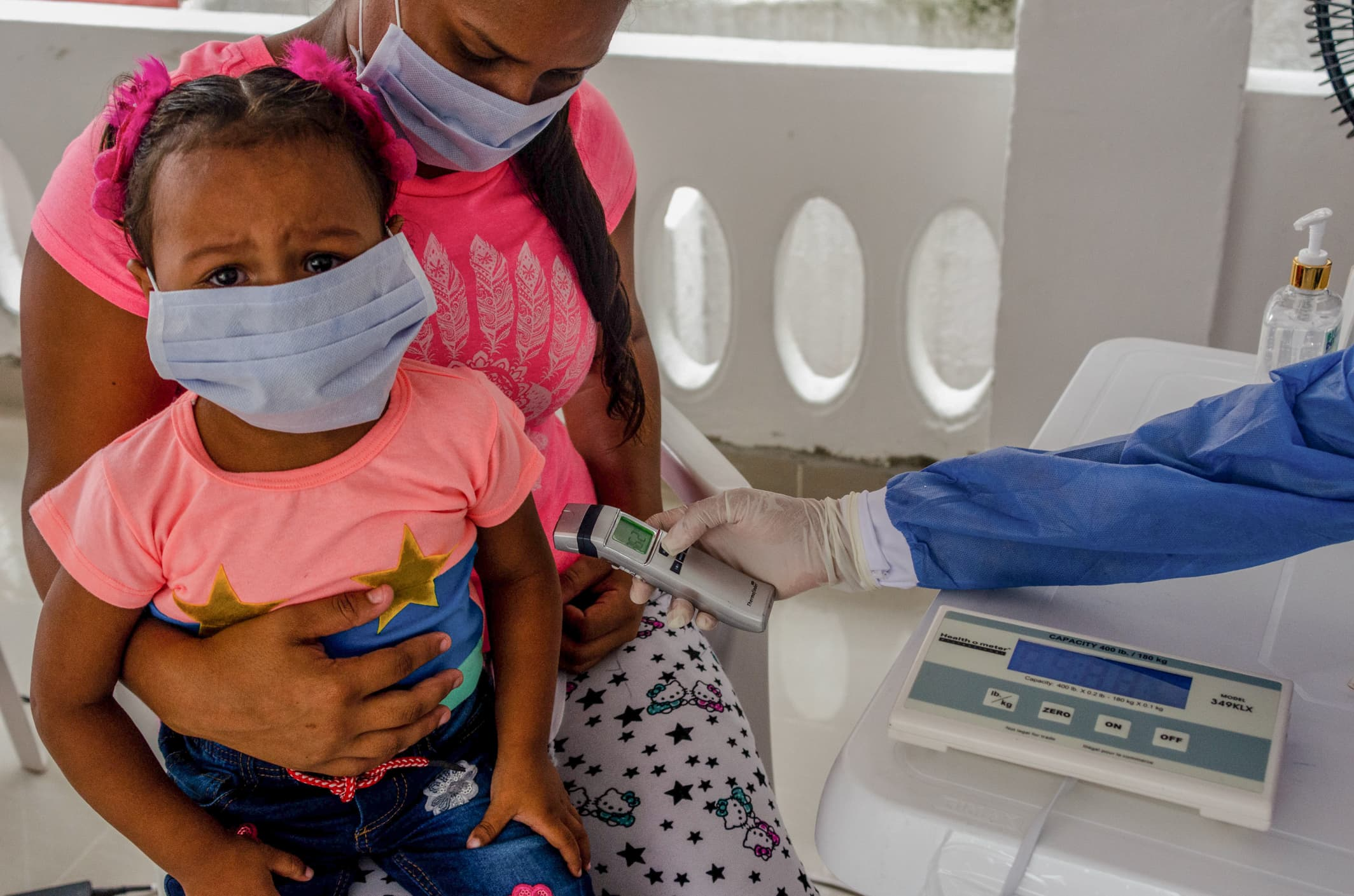 Doctor Cindy having a medical consultation with Mibian and her two-year-old daughter who is suffering from asthma. Barranquilla, Colombia,