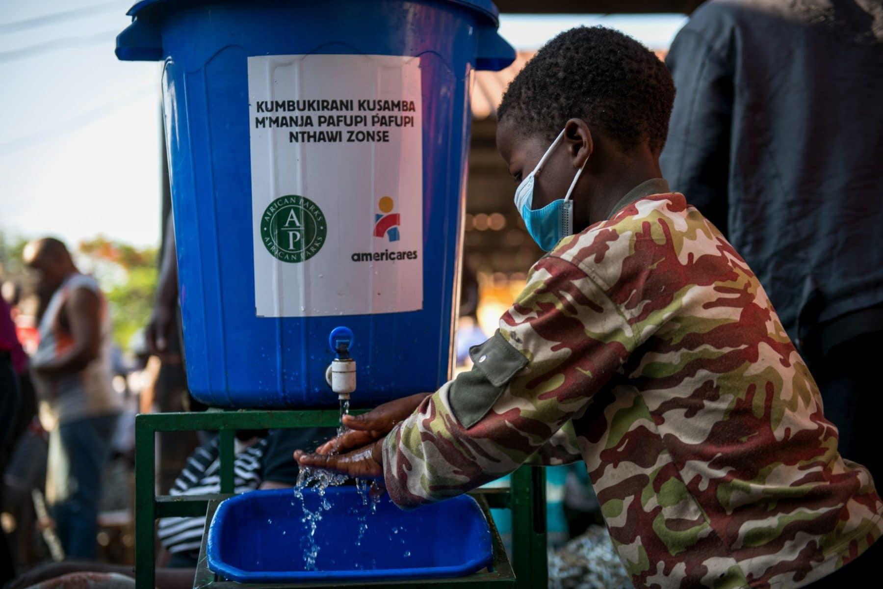Child washing his hands. Photo by Thoko Chikondi