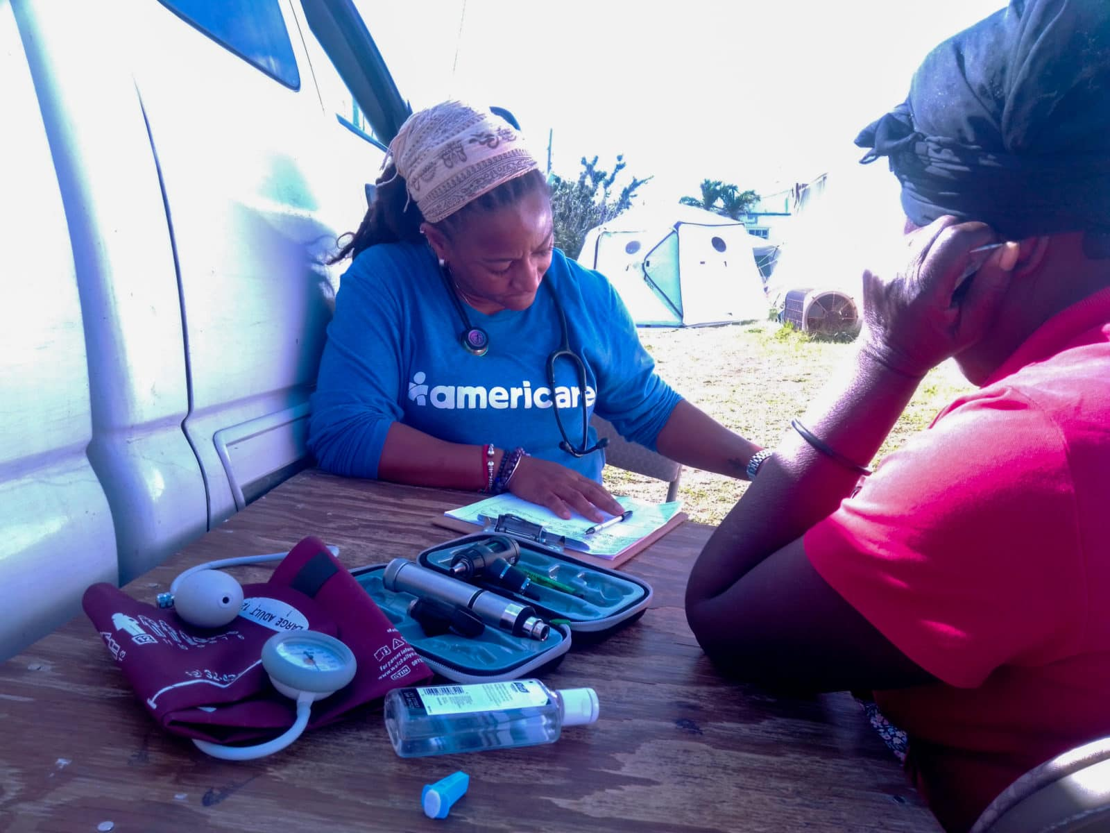 Americares's RN Geraldine Superville consulting with a patient.