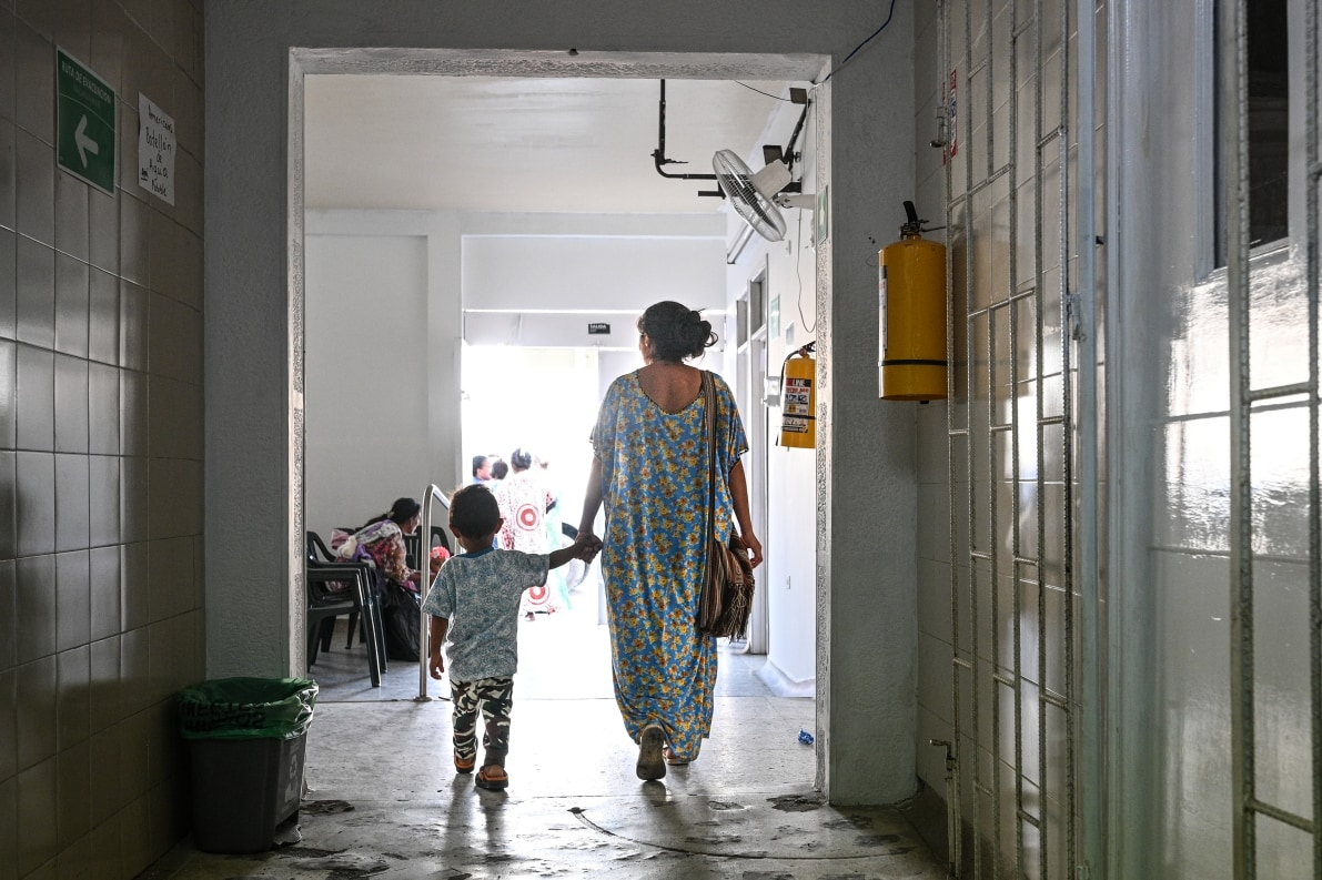 Mother bringing child to Americares clinic on Colombia Venezuela border