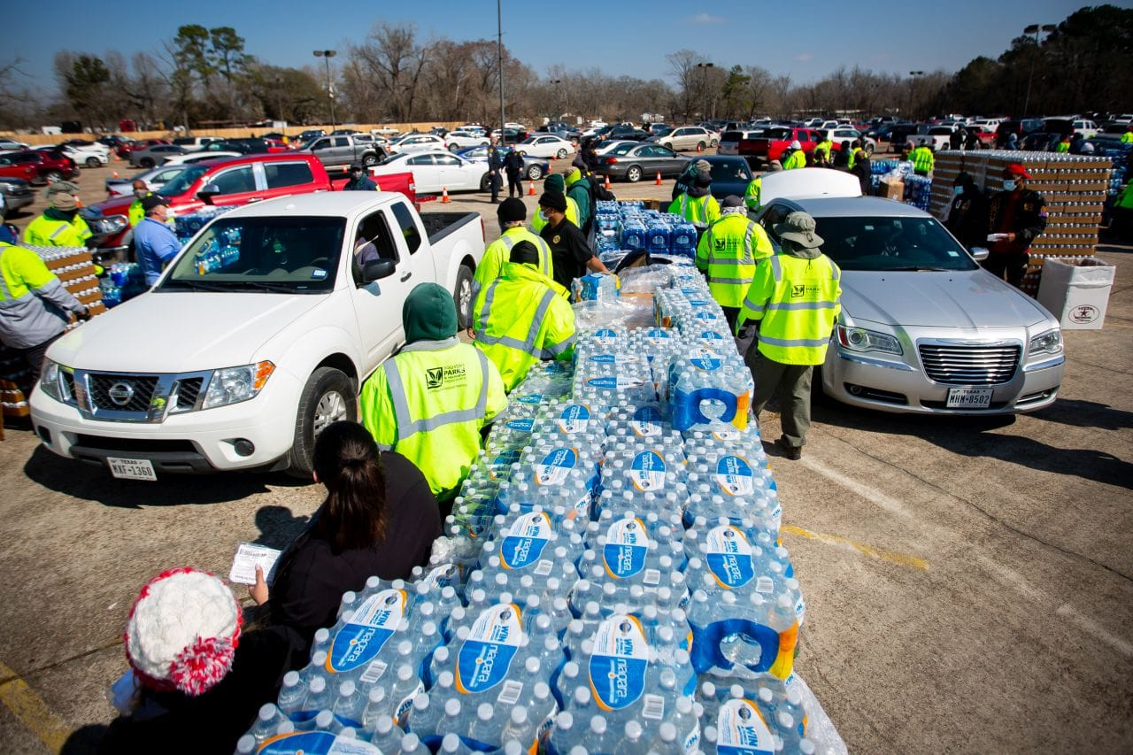 Houston city employees hand out bottled water.