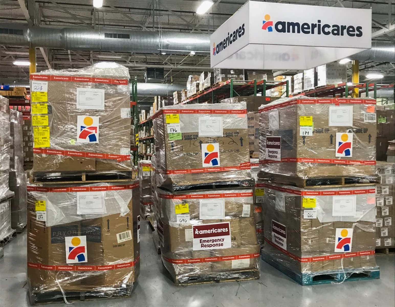 Staff of the Americares global distribution center in Stamford, Conn., prepare a series of aid shipments for Armenia. Photo by Juan Santana/Americares