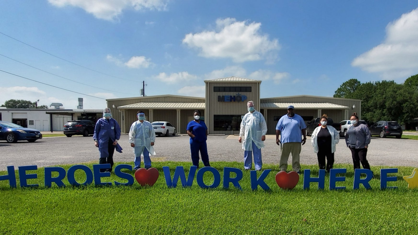 Matagorda health workers in front of a COVID Workers sign