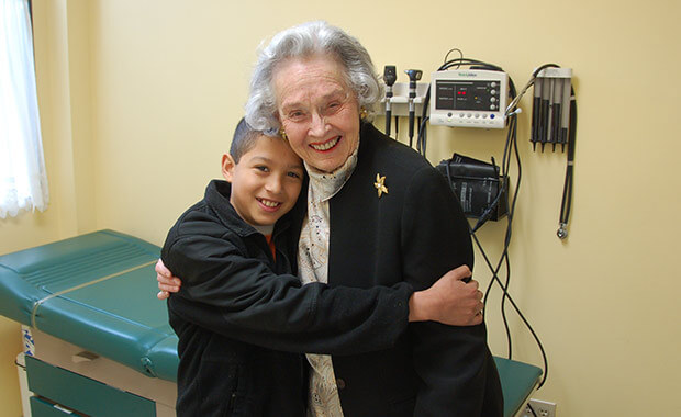 Leila at a recent Clinic visit with a patient