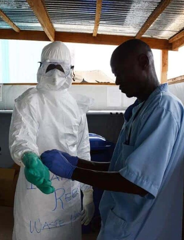 Liberian doctor puts on his PPE for Ebola