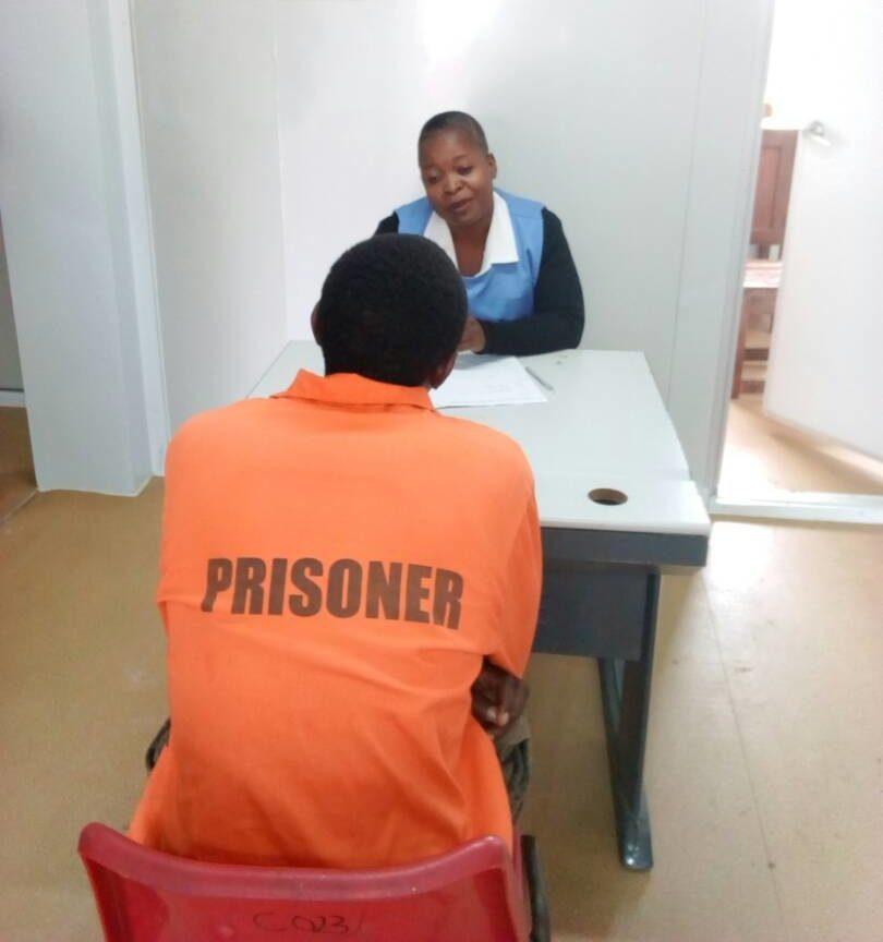 Health worker interviewing a prisoner In Zambia