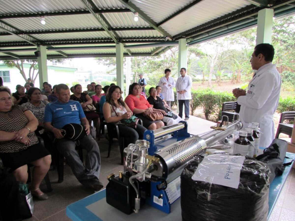 Doctor Quijano teaches a community about mosquito control.
