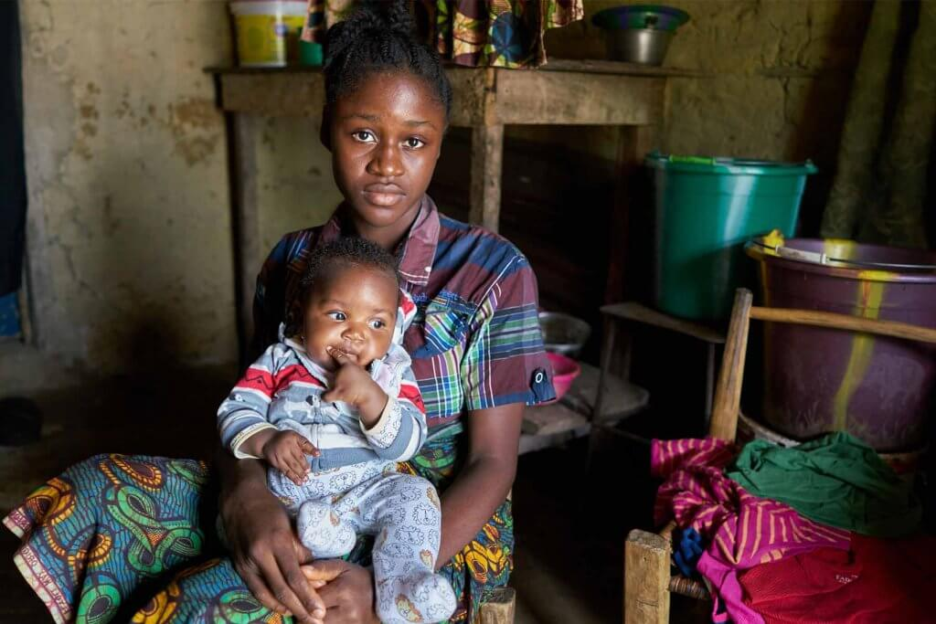 Mother and child in Liberia served by a maternal and child health center.