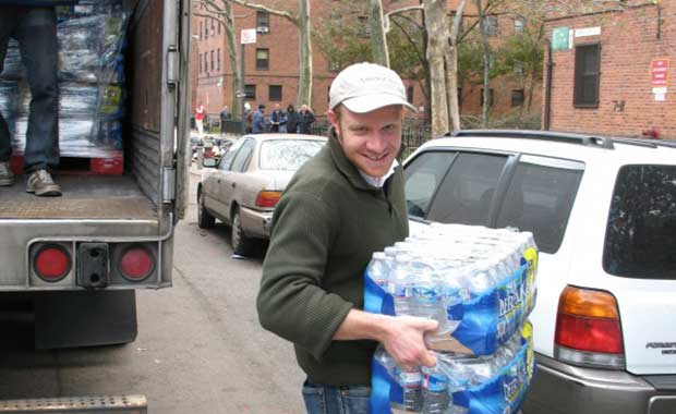 Marty offloads water at Henry Street Settlement in Manhattan.