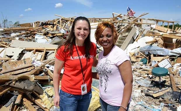 Kate with tornado survivor in Mississippi.