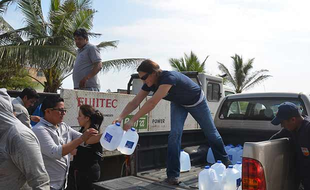Kate and team work to distribute water and other supplies to earthquake survivors