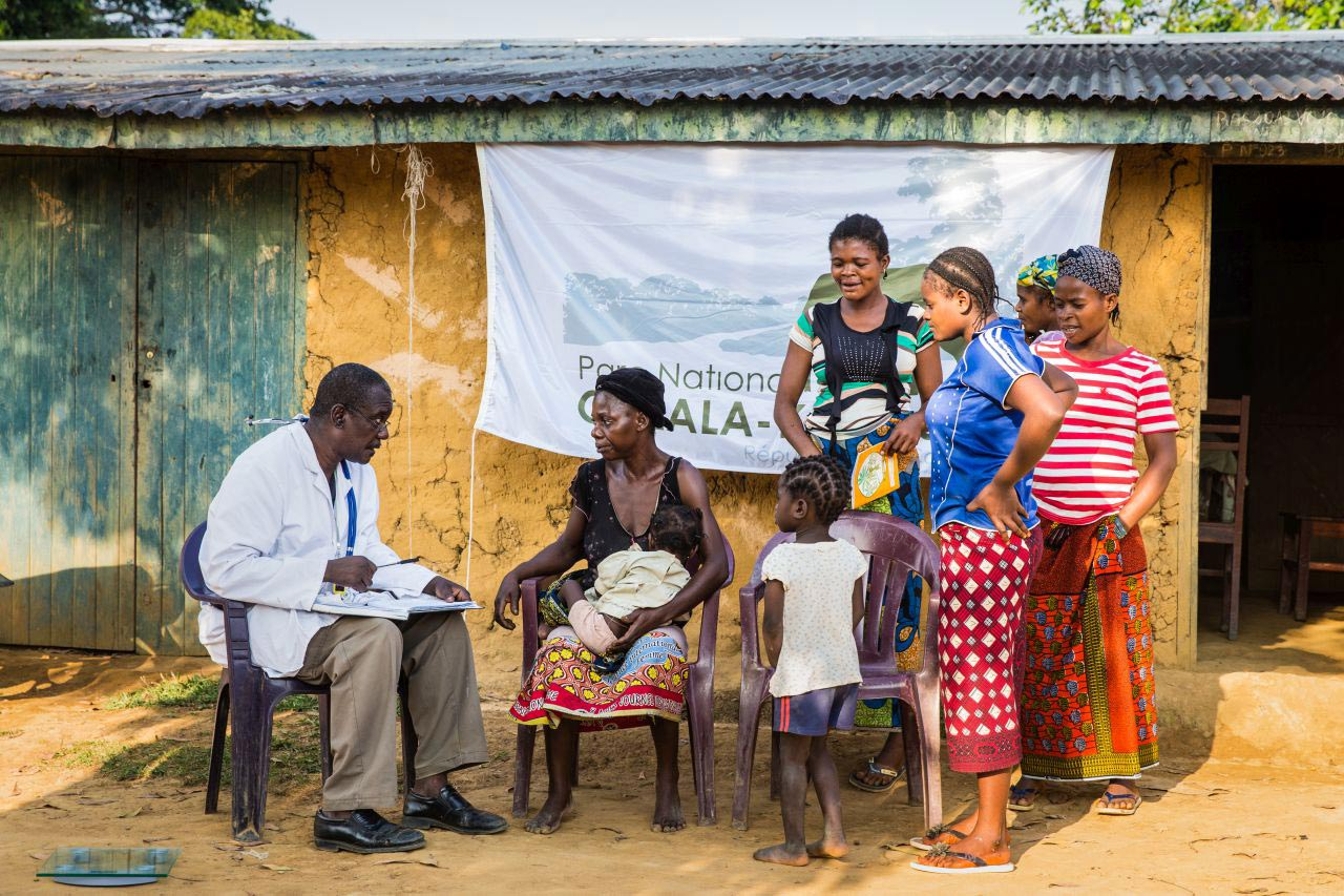Patients receive medical care near Odzala-Kokoua National Park in the Congo, one of 15 national parks and protected areas managed by African Parks. Photo by Marcus Westberg.