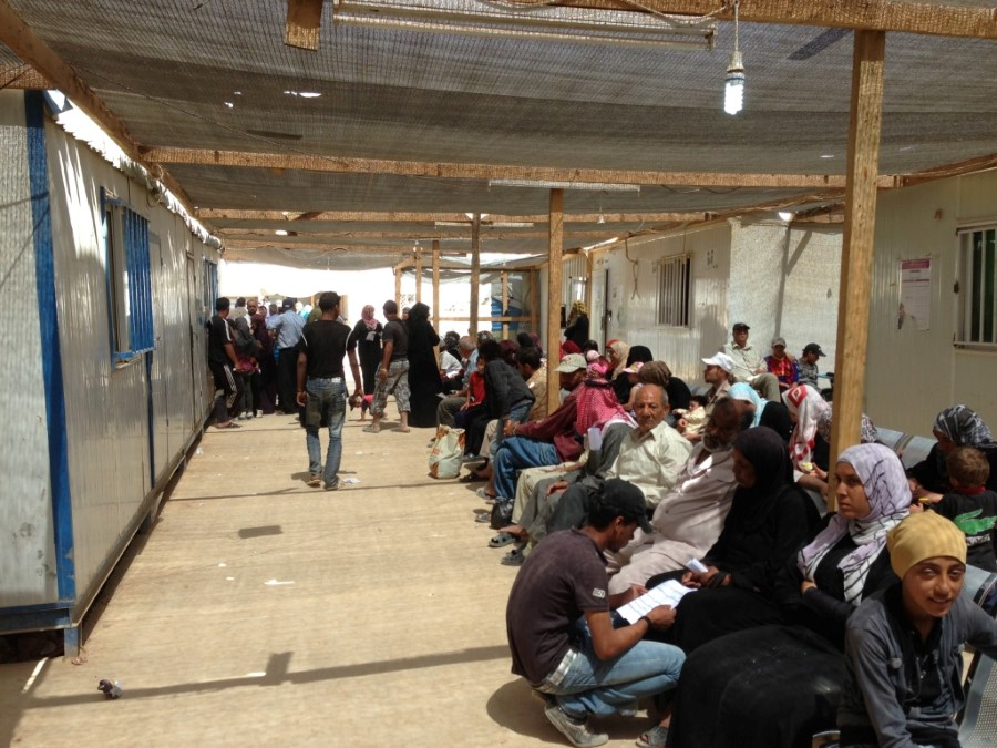 Patients awaiting care in refugee camp