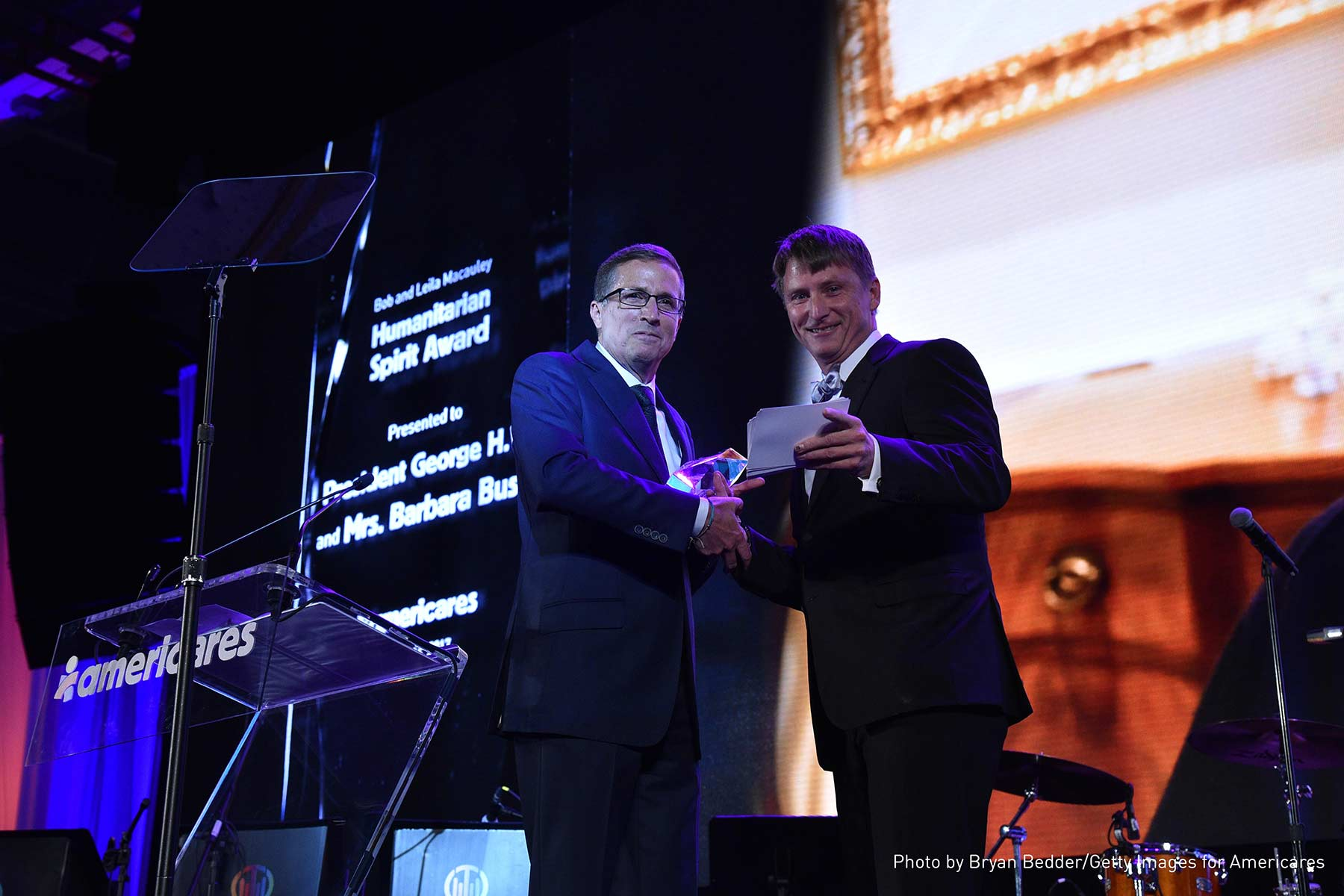 Americares President and CEO Michael J. Nyenhuis (left) presents the Bob and Leila Macauley Humanitarian Spirit Award to Jonathan Bush Jr.