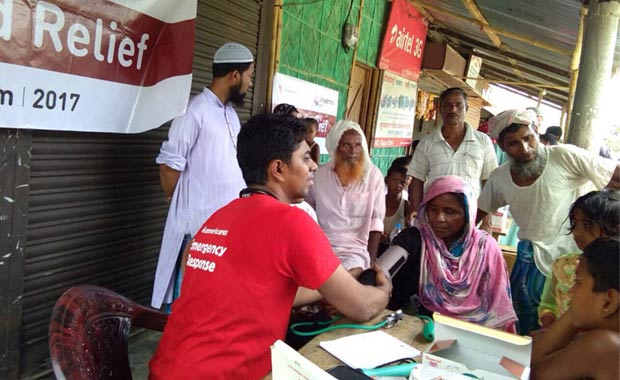 Americares volunteer Dr. Abhishek Patil examines patients at a health camp in Nowbaicha Block, Assam,  on July 16, 2017. Photo courtesy of Americares India.