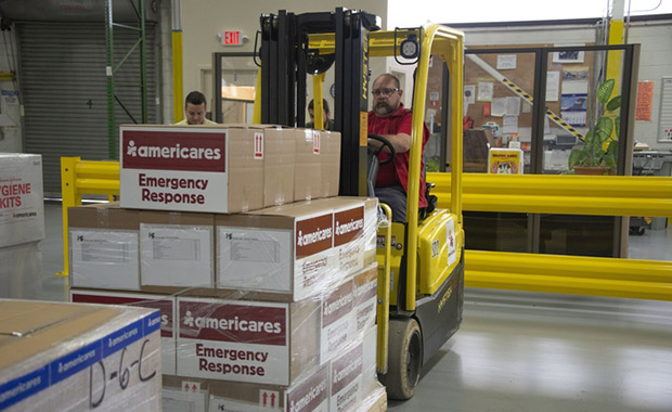 Americares employees prepare emergency supplies in the organization's Connecticut distribution center on Sept. 10, 2018, as Hurricane Florence intensifies. Photo courtesy of Americares.