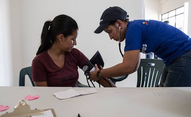 A patient receives treatment at the Americares medical clinic in Maicao, Colombia.