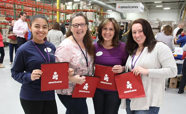 Boehringer Ingelheim volunteers Jennifer Grant, Jeannine Gagnon, Christine Zarrella and Meaghan Hart assemble first aid kits in Americares distribution center in Stamford, Conn.