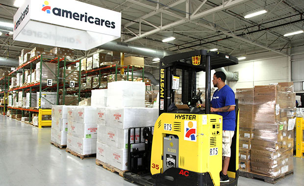 Workers at Americares distribution center in Stamford, Conn., prepare a shipment of relief supplies for survivors of the California Carr Fire.