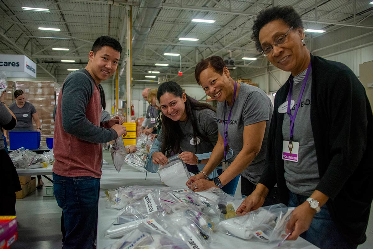 From left to right: Nestlé Waters North America volunteer Dan Trinh works alongside JPMorgan Chase volunteers Luisana Camilo, Lisabette Ware and Gloria Barker in Americares distribution center on Giving Tuesday.