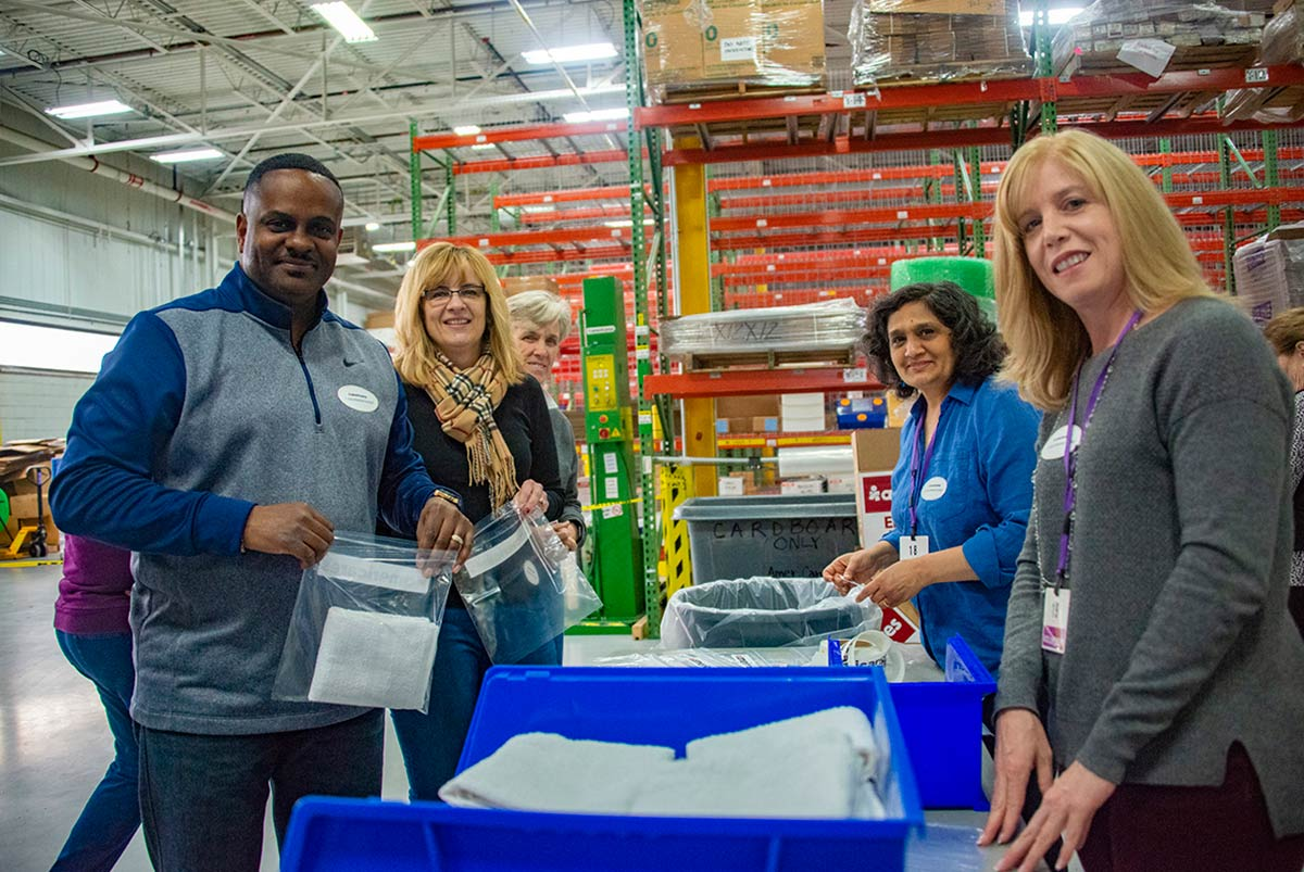 From left to right: Joe Poindexter and Suzanne Dicintio of Nestlé Waters North America, Cathy Manion of New Canaan, Sonal Vora of Stamford, and Lori Brello of Nestlé Waters North America pack hygiene kits for disaster survivors on Giving Tuesday.