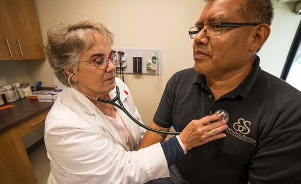 Nurse Practitioner Sue McGinnes examines a patient at Community Health Care Clinic in Normal, Ill.