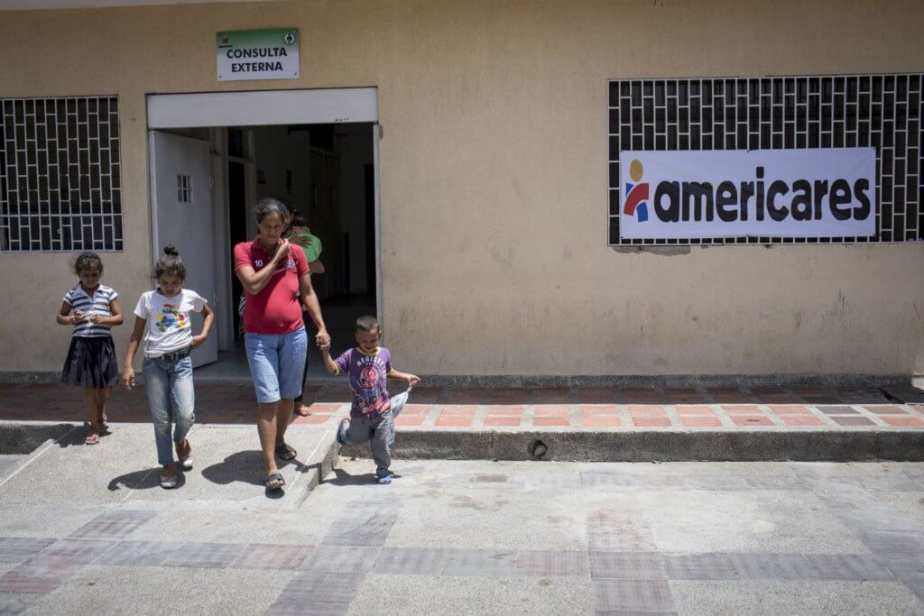 Venezuelan mother and children visiting an Americares clinic in Colombia.