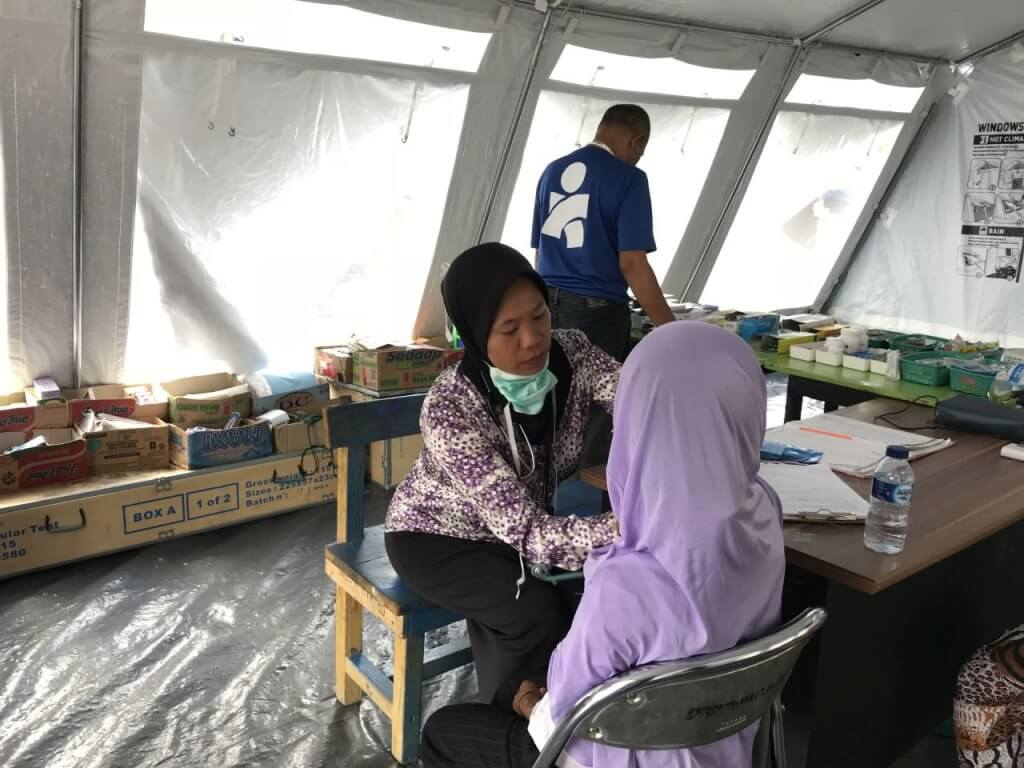 Woman visiting a temporary reproductive health center in Indonesia.