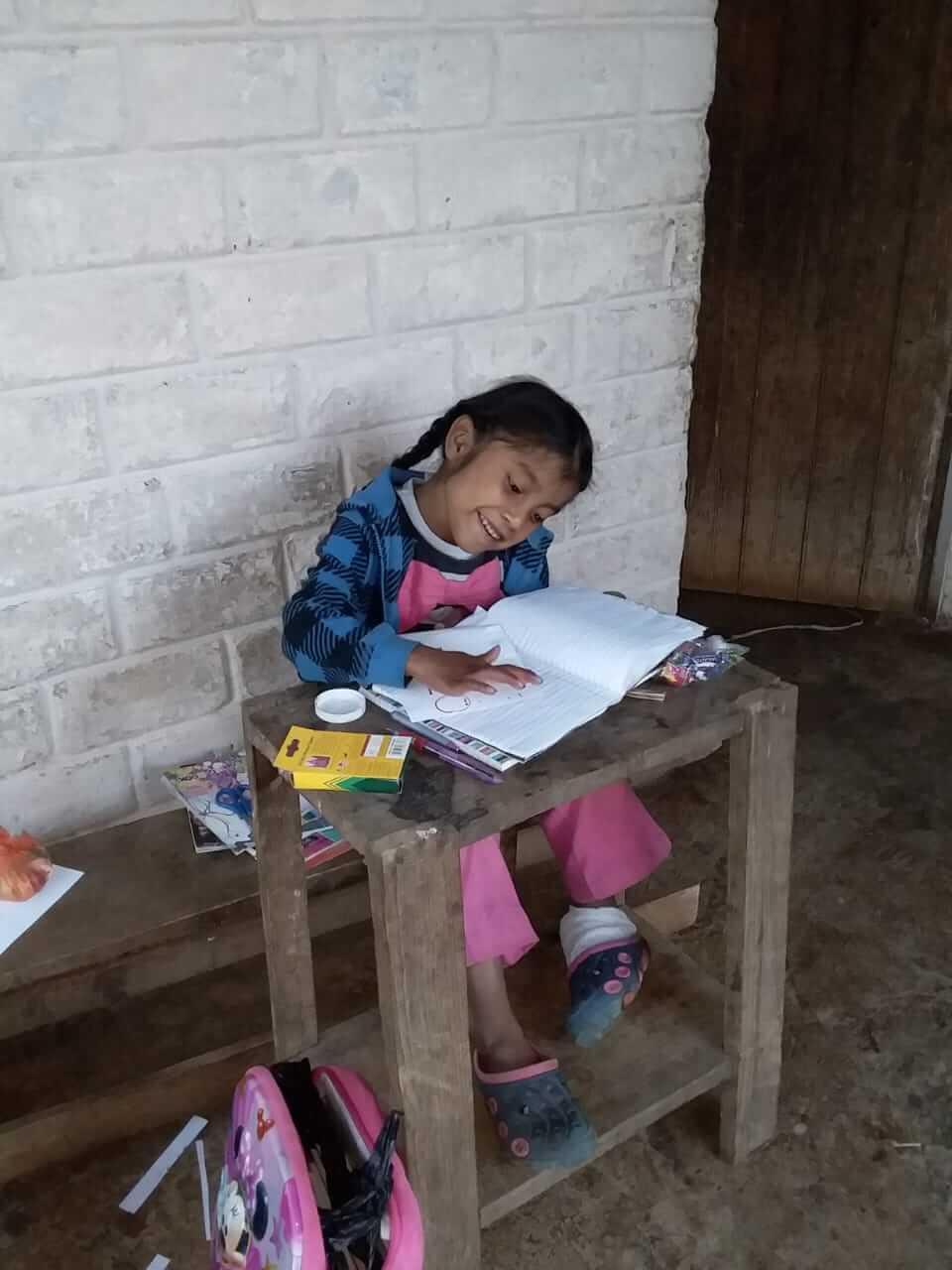 Photo of Alejandra studying