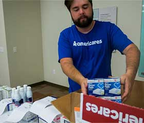 Americares worker loading medicines and supplies