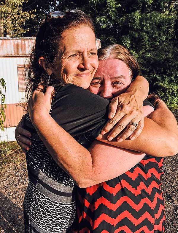 Two women hugging in joy