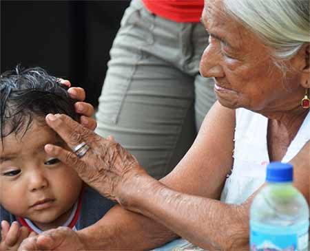 A grandmother tends to a hurt child.